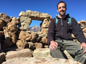 """Me at the summit cairn """"window"""" framing El Teide in the background"""