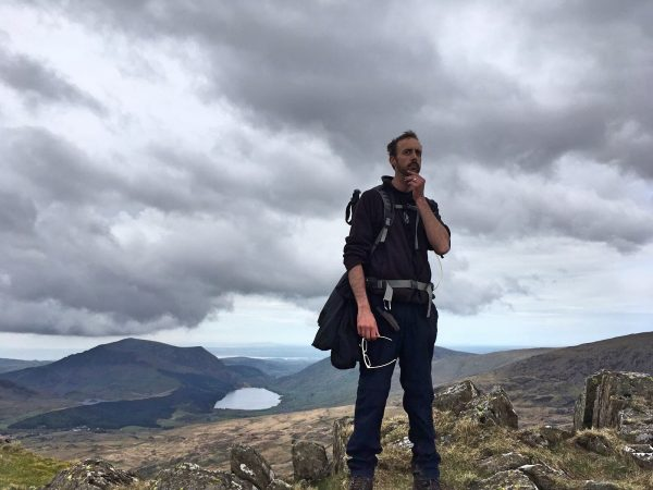 The author pondering how he can return to a desk job after all this mountain walking